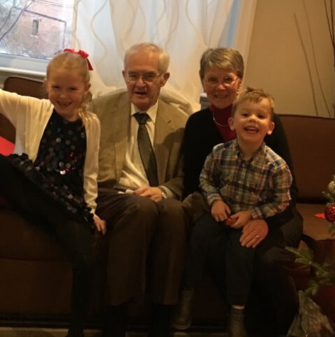 Dr. Wilson with his wife, Jean, and their grandchildren