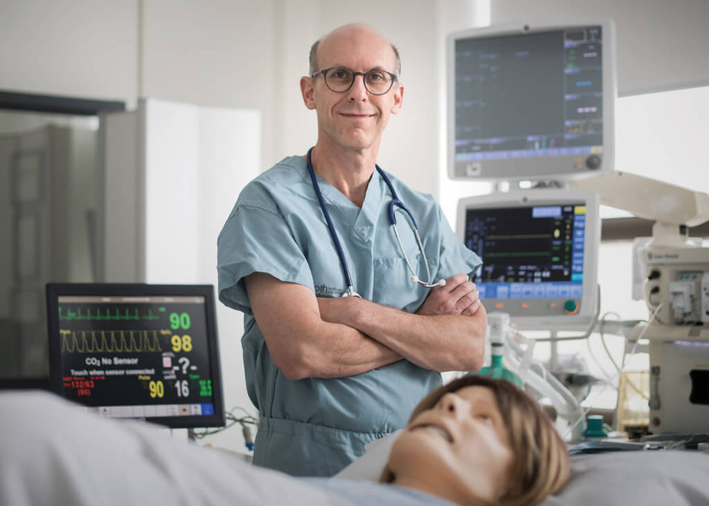 Dr. Jordan Tarshis with a mannequin in the Sunnybrook Canadian Simulation Centre