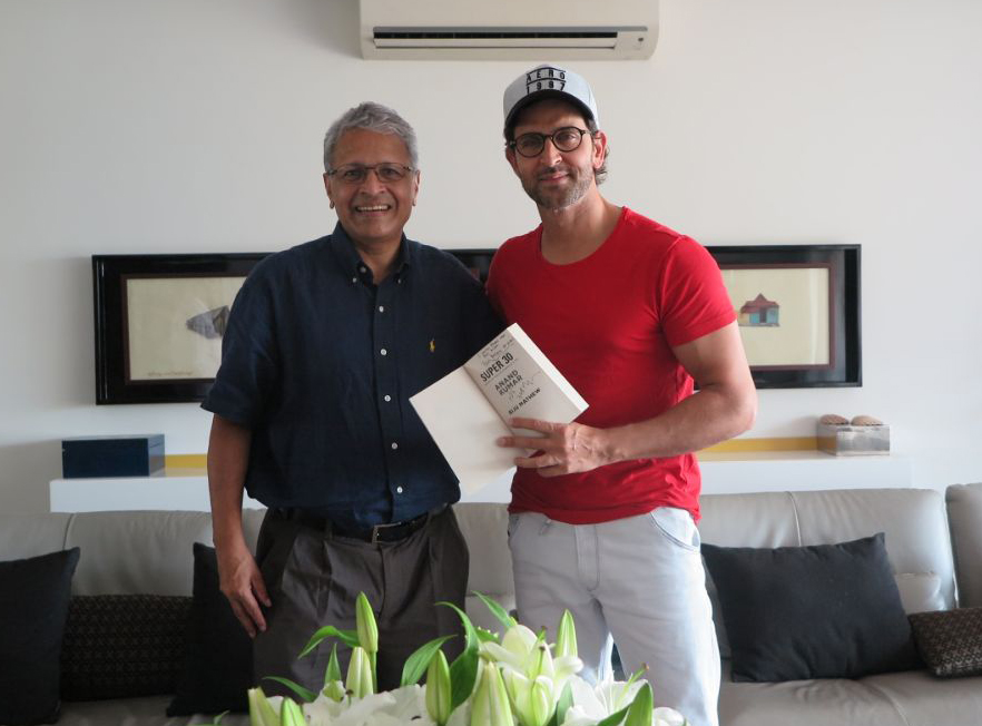 Actor Hrithik Roshan with Dr. Mathew and an autographed copy of his book, Super 30.