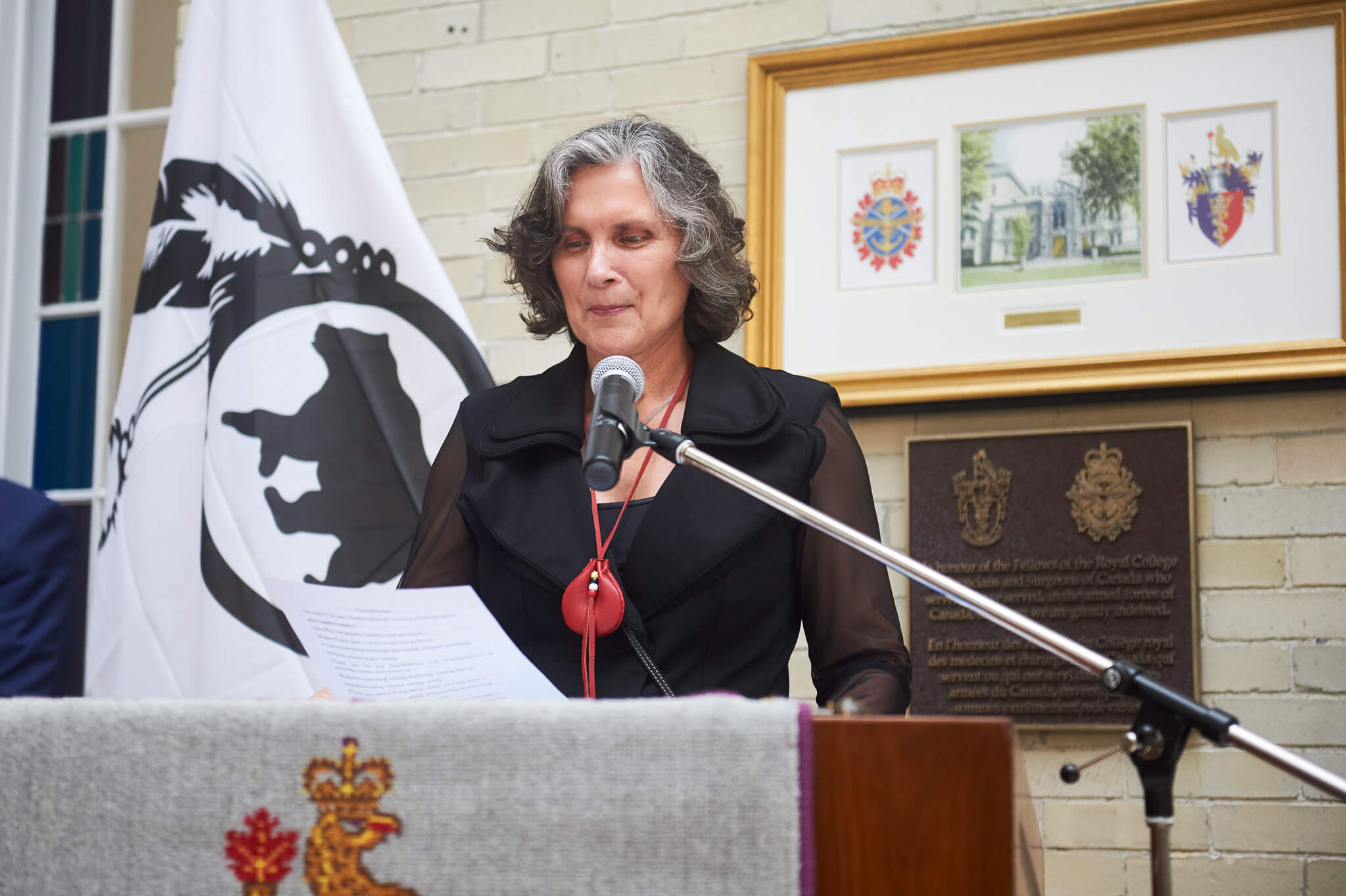 Councillor Wendy-Anne Jocko at the Algonquins of Pikwakanagan First Nation flag raising ceremony in June 2019. The flag is visible to her left.