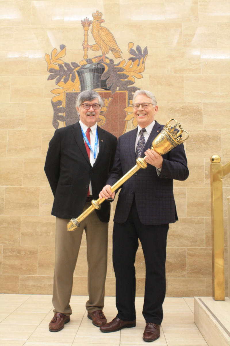 Royal College CEO Andrew Padmos, MD, FRCPC, and President Ian Bowmer, MDCM, FRCPC, pose with the newly returned mace.